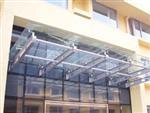 定做钢化玻璃雨棚朝阳区建国路安装钢结构玻璃雨棚